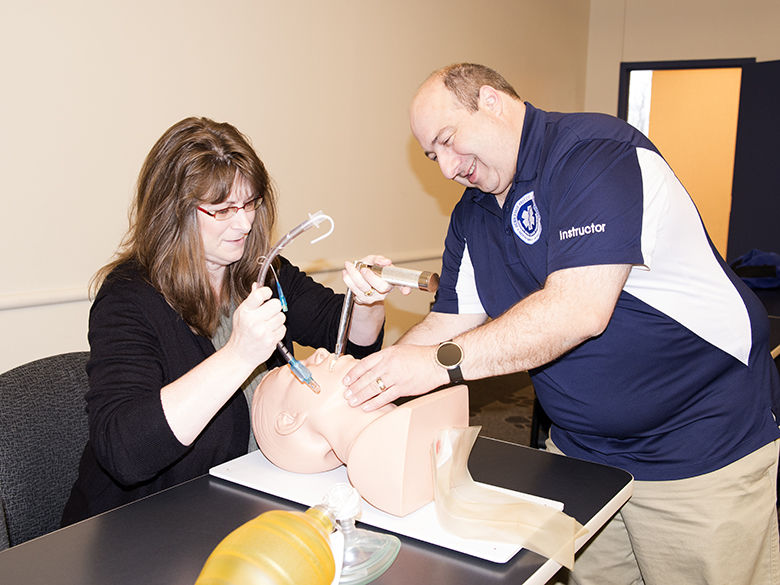 Professor teaching a paramedic technique.
