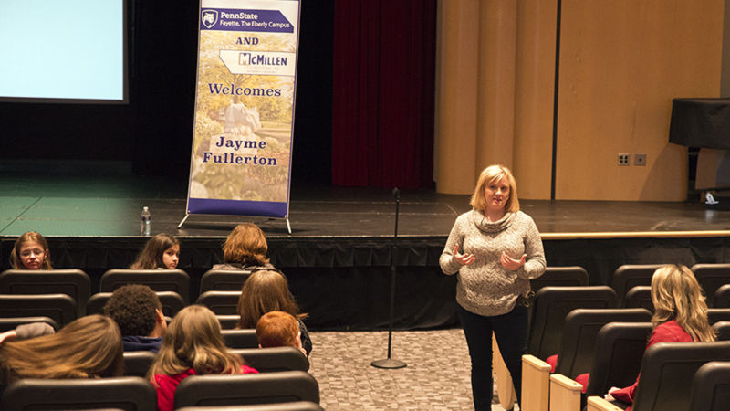 Jayme Fullerton answering questions from the audience.