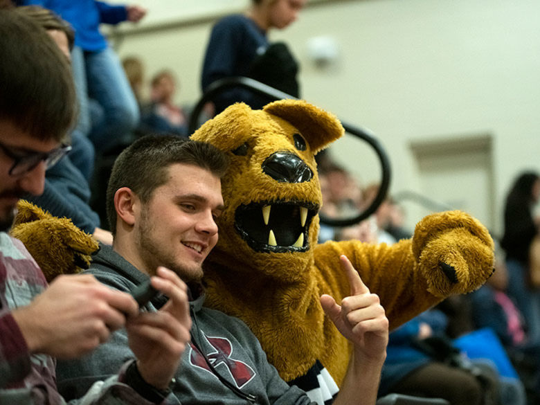 Lion with student and a basketball game.