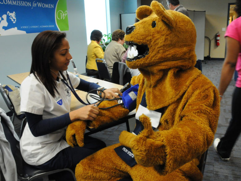 Nittany Lion visiting a nurse