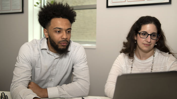 Jamar Dues (left) and Mary Budinsky (right) work together in a private tutoring room in the Student Success Center.