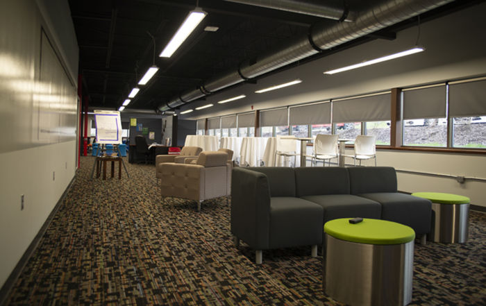 View of the couches and cubicles.