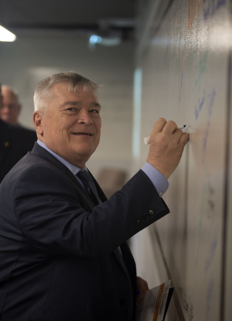Dr. Eric Barron signs the Fayette LaunchBox wall of fame.
