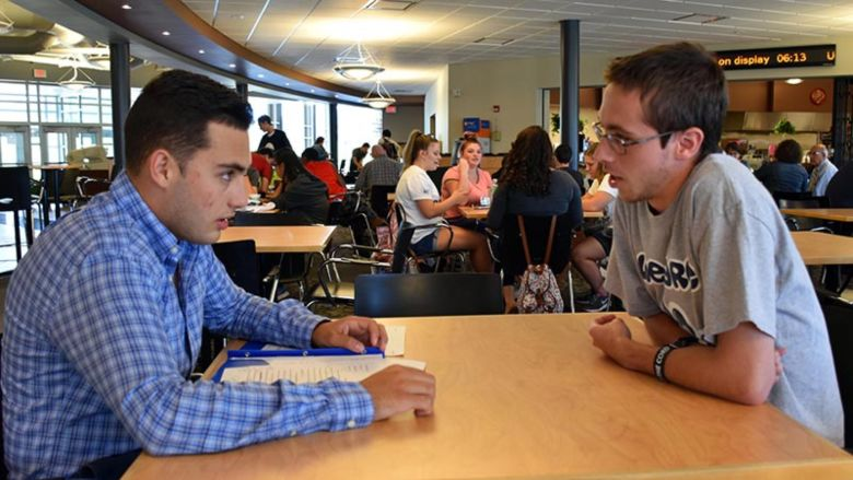 William Guseman (right) mentors first-year student David D'Antonio. Both participated in this summer's PaSSS program, which provides financial and educational support to students, helping them to graduate on time.