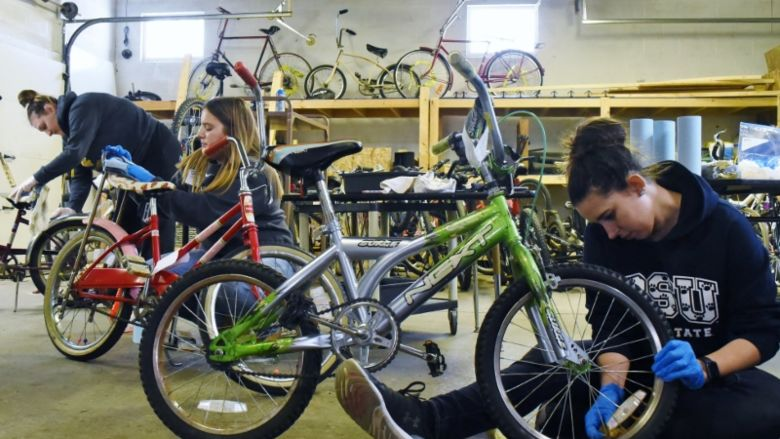 Penn State students repair bicycles during a Martin Luther King Jr. Day service project.