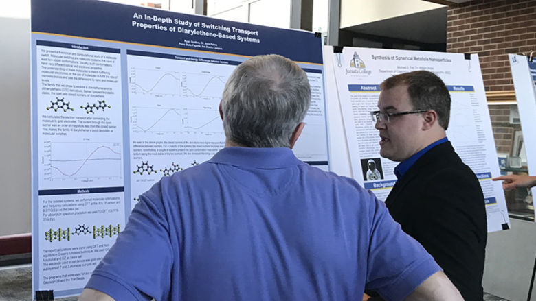 Ryan Godbey presents his research at chemistry symposium.