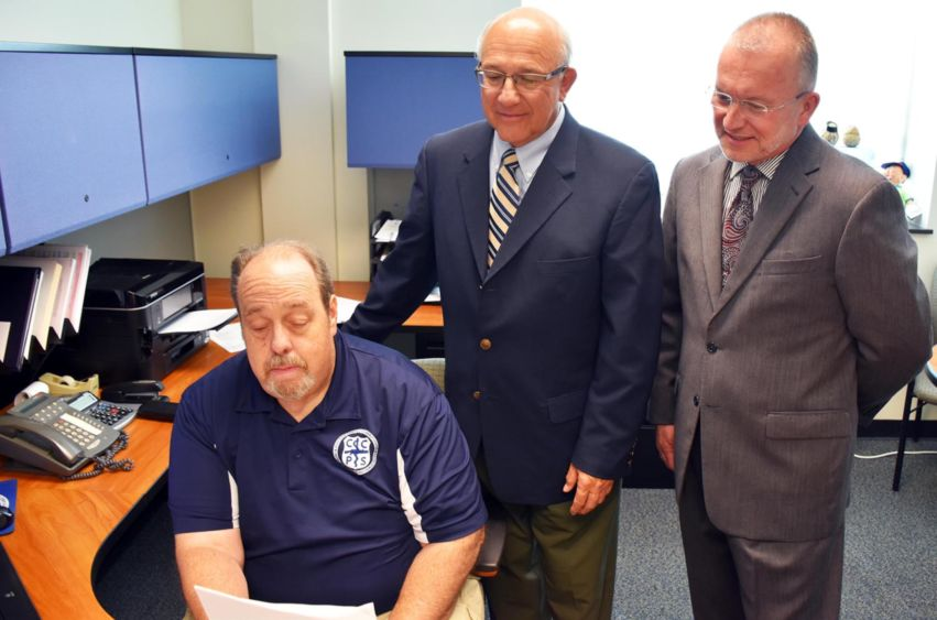 Pictured reviewing the contracts are, from left, CCPS Director Ted Mellors, Outreach and Continuing Education Director Joseph Segilia, and Chancellor and Chief Academic Officer Dr. Charles Patrick.